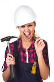 Woman working with a hammer — Stock Photo
