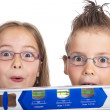 Two children with spirit level — Stock Photo