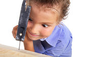 Child works with hammer — Stock Photo