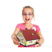 Girl with house model — Stock Photo