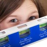 Young girl looking through water balance — Stock Photo