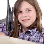 ハンマーと釘を持つ若い女の子 — ストック写真 #28673311