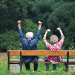 Stock Photo: Retired couple on park bench