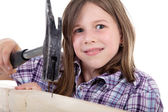 Young girl with hammer and nail — Stock Photo