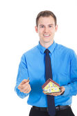 Young business man with miniature house — Stock Photo