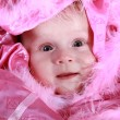 Stock Photo: Little girl on a pink blanket
