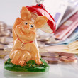 Chessboard with Euro coins and happiness pig — Stock Photo