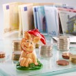 Chessboard with Euro coins and happiness pig — Stock Photo #30892763