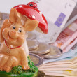 Chessboard with Euro coins and happiness pig — Stock Photo #30892799