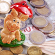 Chessboard with Euro coins and happiness pig — Stock Photo #30892809