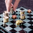Chessboard with Euro coins — Stock Photo