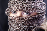 Pretty oriental woman shows eyes — Stock Photo