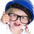 Girl in a helmet showing sign — Stock Photo