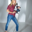 Blonde girl with a drill — Stock Photo