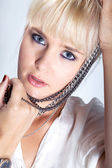Blonde girl with a necklace — Stock Photo