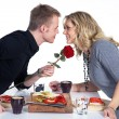 Couple kissing on a romantic dinner — Stock Photo