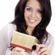Brunette girl with a brush — Stock Photo