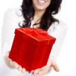 Brunette girl with a gift — Stock Photo