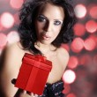 Brunette girl with a gift — Stock Photo #34964655