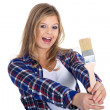 Blonde girl with a brush — Stock Photo