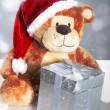 Santa bear with gift box and lights bouquet — Stock Photo