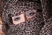 Girl's face in brindle headscarf — Stock Photo