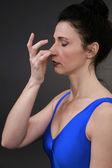 Woman doing yoga breathing alternate — Stock Photo