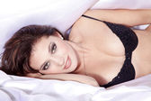 Pretty woman in bed — Stock Photo