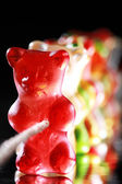 Rubber bear pulling on rope — 图库照片