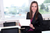 Businesswoman with white card — Stock Photo
