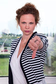 Businesswoman showing sign — Stock Photo