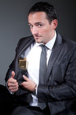 Businessman with gold in his pocket — Stock Photo