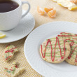 Christmas cookies and a cup of tea - Stock Photo