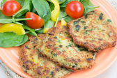 Quinoa fritters with salad — Stock Photo