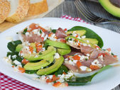 Salad with avocado anв prosciutto — Stock Photo