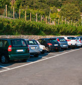 Cars parked in series — Stock Photo