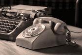 Vintage typewriter and telephone — Стоковое фото