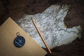 Old compass and vintage map — Stock Photo