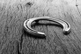 Horse shoes on wood — Zdjęcie stockowe