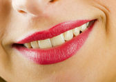 Smiling lips with lipstick — Stock Photo