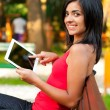 Happy girl showing on tablet — Stock Photo