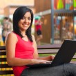 Smiling woman with laptop — Stock Photo