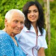 Outdoors with an elderly woman — Stock Photo