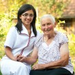 Stock Photo: Caring doctor with elderly woman