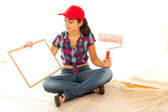 Painter with clipboard and roll brush — Stock Photo