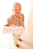 Senior man with paint roller — Stock Photo