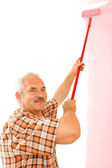 Senior man renovating home — Stock Photo