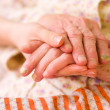 Caring hands - helping the needy - Stockfoto