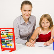 Stock Photo: Happy student and teacher learning together