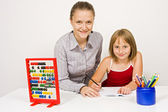 Happy student and teacher learning together — Stock Photo